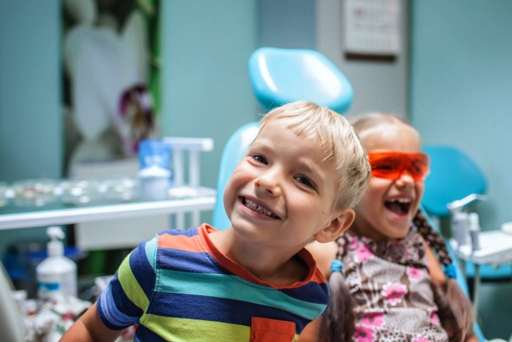 two-kids-having-fun-and-wearing-medical-eyeglasses-during-visit-to-dentist-office-office-teeth-oral-Vaughn-Family-Dental-Best-Dentist-in-Independence-Missouri-MO